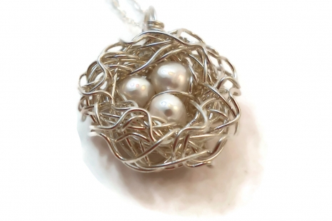 Three egg bird nest pendant with white pearls